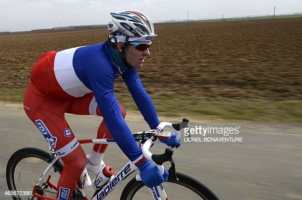 France's Arnaud Demare rides in the pack during the first stage of the 73rd edition of the ParisNice cycling race between SaintRemylesChevreuse and...