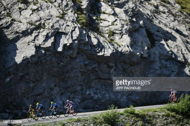 France's Arthur Vichot and Spain's Alejandro Valverde ride down a slope during the eleventh stage of the 105th edition of the Tour de France cycling...