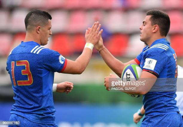France's Arthur Vincent is congratulated by his teammate France's Adrien Seguret after scoring a tryduring the Rugby Union World Cup U20 championship...