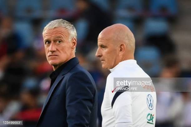 France's assistant coach Guy Stephan and France's head coach Didier Deschamps react prior to the FIFA World Cup Qatar 2022 qualification Group D...