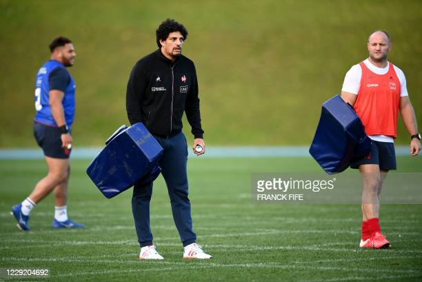 France's assistant coach Karim Ghezal and William Servat attend a a training session on October 21 2020 in Marcoussis south of Paris as part of the...
