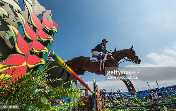France's Astier Nicolas on Piaf de B'Neville clears an obstacle during the Eventing Team Jumping Final of the Equestrian competition during the 2016...