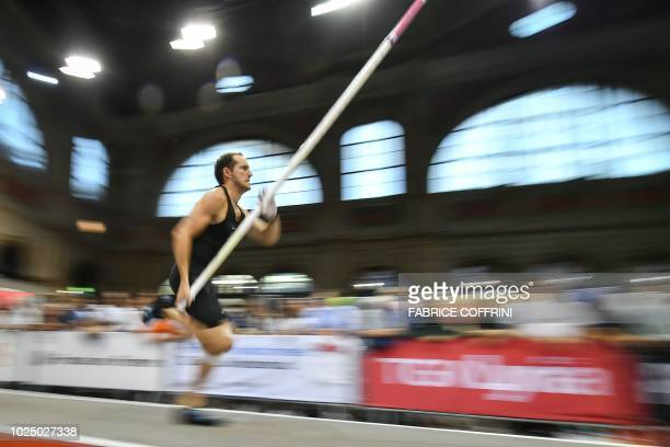 France's athlete Renaud Lavillenie competes in the men's pole vault event inside Zurich's main railway station during the IAAF Diamond League...