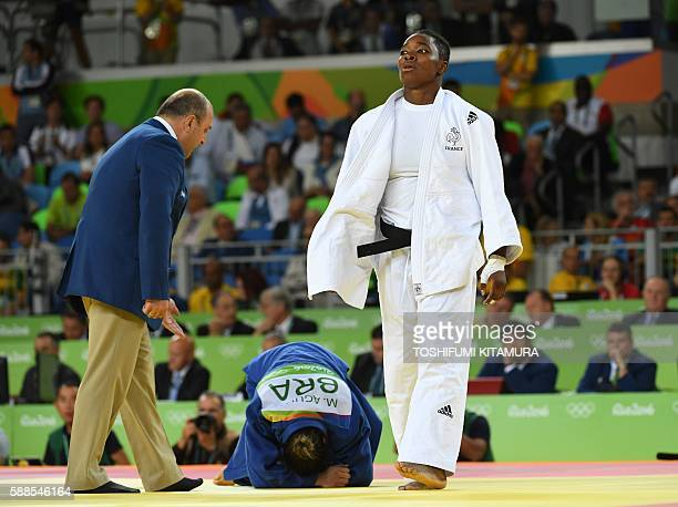 France's Audrey Tcheumeo celebrates after defeating Brazil's Mayra Aguiar competes with during their women's 78kg judo contest semifinal B match of...