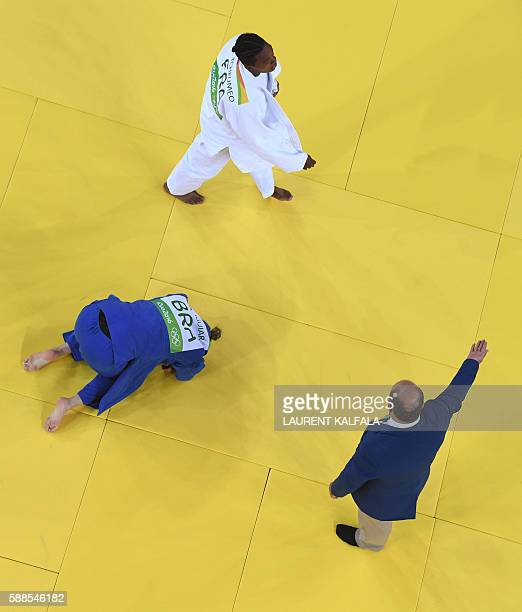 France's Audrey Tcheumeo celebrates after defeating Brazil's Mayra Aguiar during their women's 78kg judo contest semifinal B match of the Rio 2016...