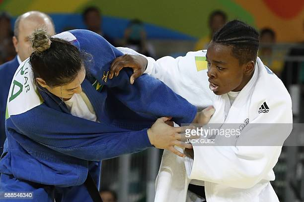 France's Audrey Tcheumeo competes with Brazil's Mayra Aguiar during their women's 78kg judo contest semifinal B match of the Rio 2016 Olympic Games...