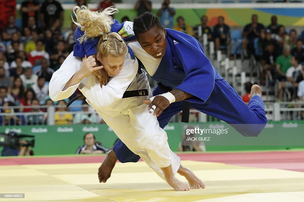 TOPSHOT - France's Audrey Tcheumeo (blue) competes with US Kayla Harrison during their women's -78kg judo contest gold medal match of the Rio 2016 Olympic Games in Rio de Janeiro on August 11, 2016. / AFP / Jack GUEZ