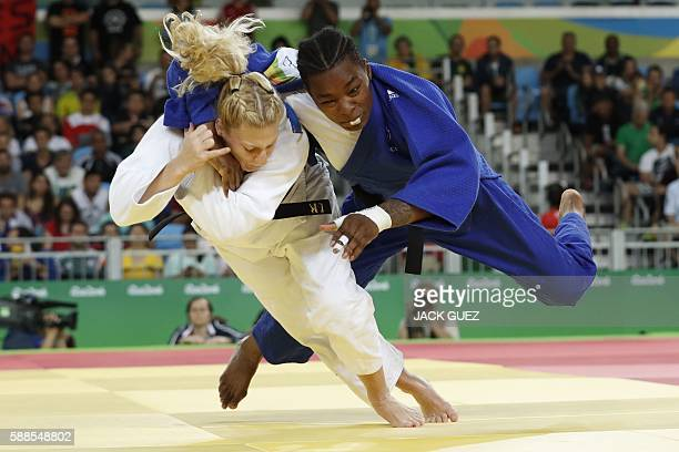 TOPSHOT France's Audrey Tcheumeo competes with US Kayla Harrison during their women's 78kg judo contest gold medal match of the Rio 2016 Olympic...