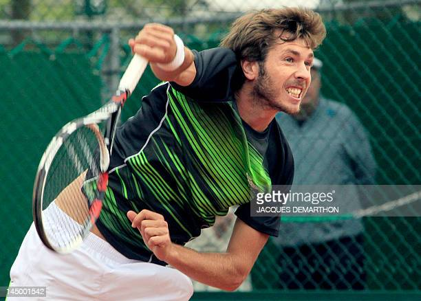 France's Augustin Gensse returns to Italy's Stefano Galvani on May 22 2012 at the Roland Garros stadium in Paris during the first round qualification...