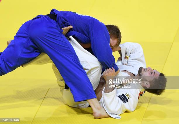 France's Axel Clerget competes with Germany's Marc Odenthal in their 90kg match of the team event at the World Judo Championships in Budapest on...
