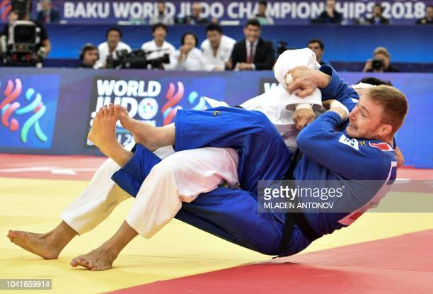 TOPSHOT France's Axel Clerget fights against Japan's Shoichiro Mukai in the mixed team final block at the 2018 Judo World Championships in Baku on...