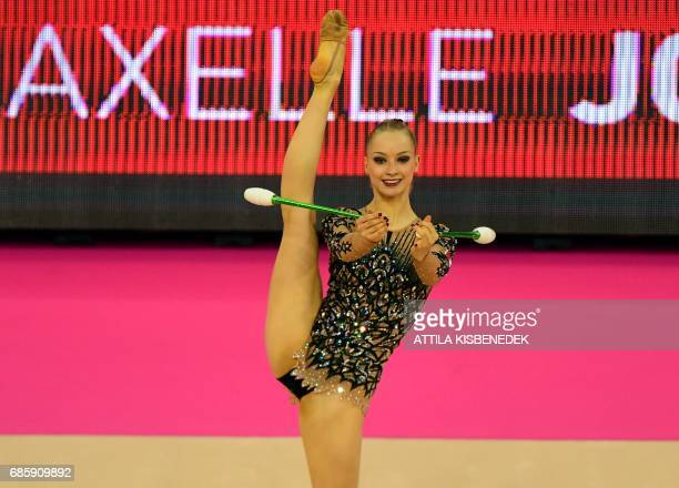 France's Axelle Jovenin performs with her clubs during the 33rd Rhythmic Gymnastics European championships in Budapest Hungary on May 20 2017 / AFP...