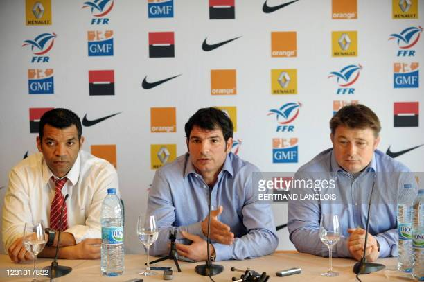 France's back coach Emile Ntamack, head coach Marc Lievremont and forward coach Didier Retiere speak to journalists during a press conference one day...