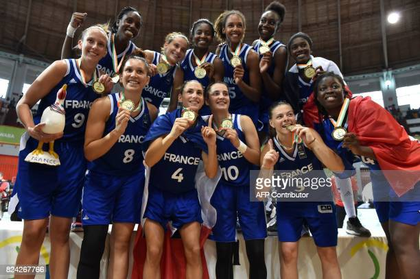 France's basketball players pose on the podium with their gold medals after winning the women's final baketball match between France and Canada...