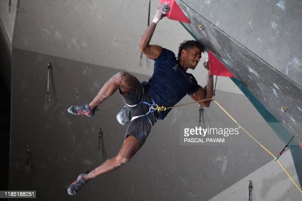 France's Bassa Mawen competes in the Boulder qualification event during the Olympic Climbing Tournament ahead of the Tokyo 2020 Summer Olympics in...