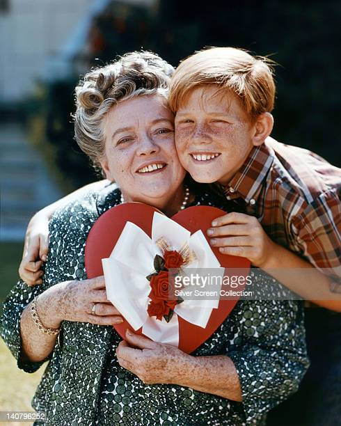 Frances Bavier US actress and Ron Howard US actor pose cheek to cheek in portrait both holding a heartshaped box of chocolates issued as publicity...