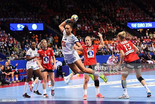 France's Beatrice Edwige prepares to throw the ball during the Women's European Handball Championship semi final match between France and Norway in...