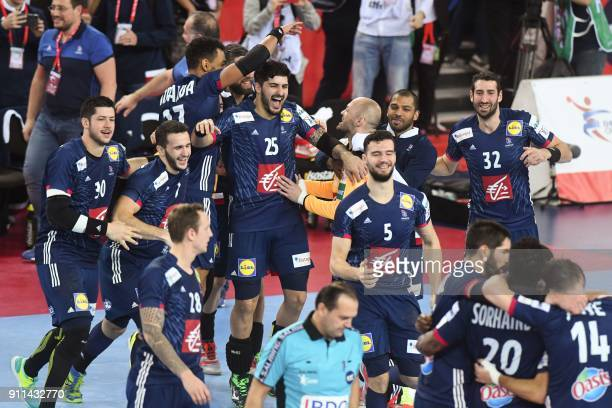 France's Benjamin Afgour France's Raphael Caucheteux France's Nicolas Tournat and teammates celebrate winning the match for third place of the Men's...