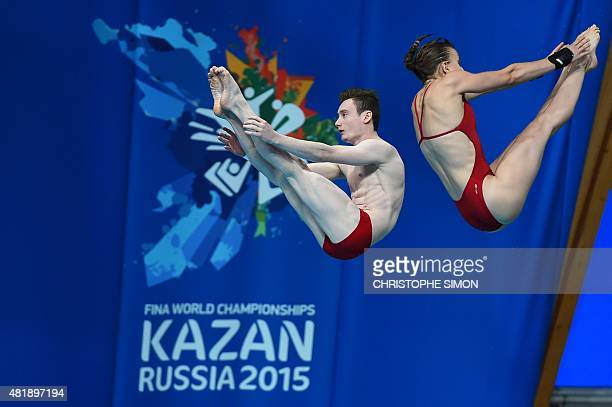 France's Benjamin Auffret and Laura Marino compete in the 10m platform synchronised mixed final diving event at the 2015 FINA World Championships in...