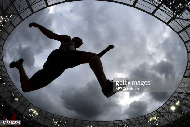 France's Benjamin Compaore competes in the qualifying round of the men's triple jump athletics event at the 2017 IAAF World Championships at the...