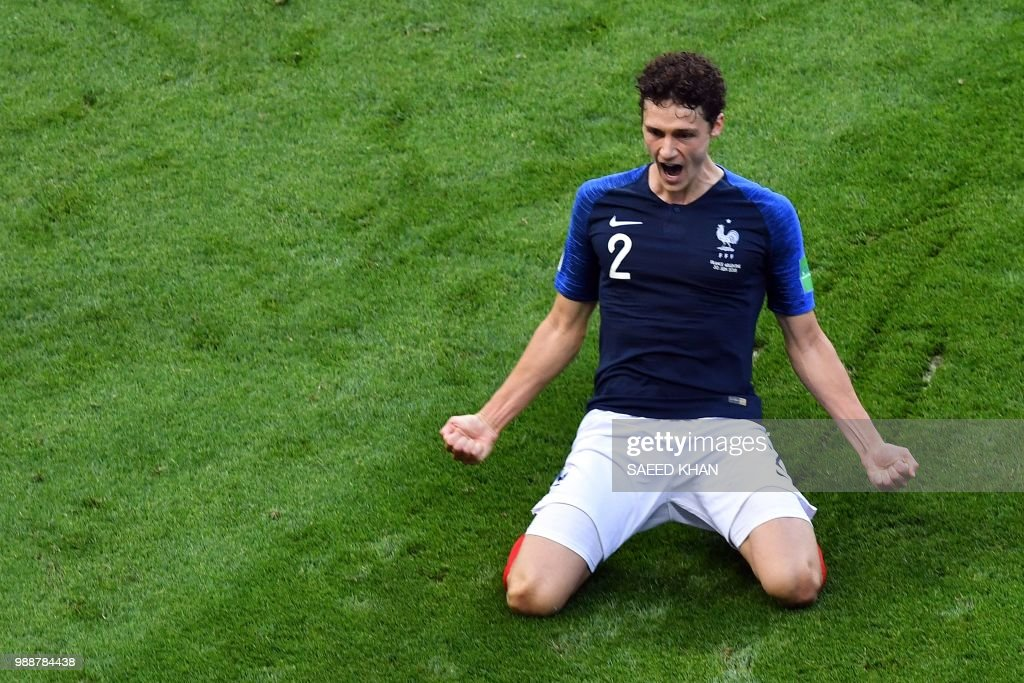 TOPSHOT - France's Benjamin Pavard celebrates after scoring his team's second goal during the Russia 2018 World Cup round of 16 football match between France and Argentina at the Kazan Arena in Kazan on June 30, 2018. (Photo by SAEED KHAN / AFP) / RESTRICTED