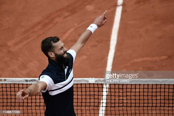 France's Benoit Paire celebrates after winning against France's PierreHugues Herbert at the end of their men's singles second round match on day four...