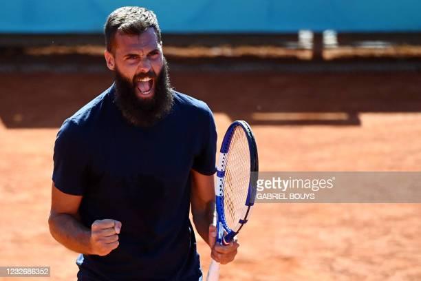 France's Benoit Paire celebrates winning the first set to Georgia's Nikoloz Basilashvili during their 2021 ATP Tour Madrid Open tennis tournament...