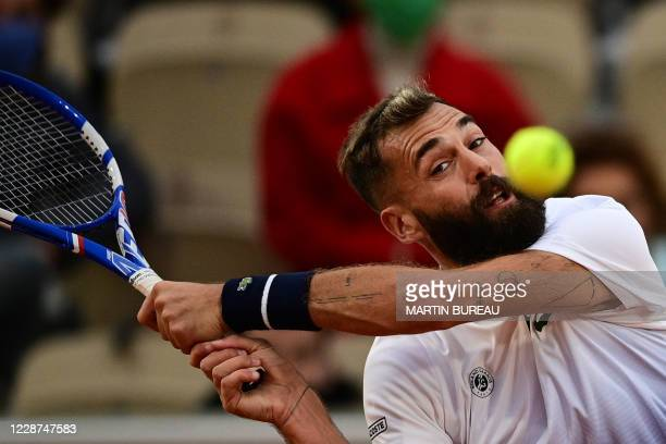France's Benoit Paire eyes the ball as he plays a backhand return to South Korea's Kwon Soon-woo during their men's singles first round tennis match...