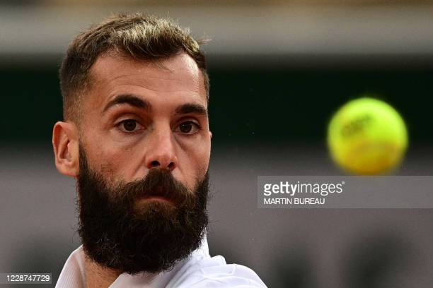 France's Benoit Paire eyes the ball as he returns the ball to South Korea's Kwon Soon-woo during their men's singles first round tennis match on Day...