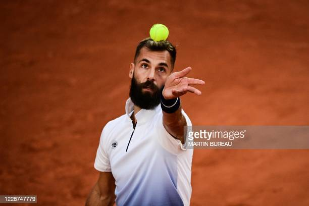 France's Benoit Paire eyes the ball as he serves to South Korea's Kwon Soon-woo during their men's singles first round tennis match on Day 1 of The...