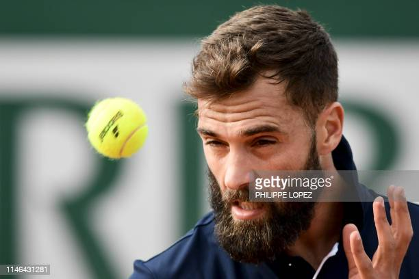 France's Benoit Paire eyes the ball before hitting the ball to Romania's Marius Copil during their men's singles first round match on day two of The...