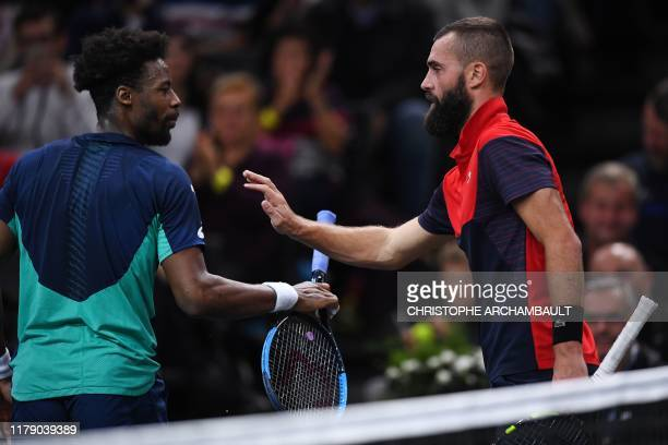France's Benoit Paire gestures towards France's Gael Monfils during their men's singles tennis match on day three of the ATP World Tour Masters 1000...
