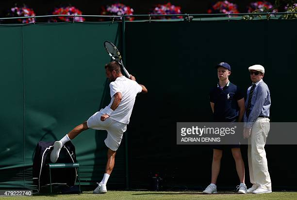 France's Benoit Paire kicks the line judge's chair after losing a point during his men's singles second round match against Spain's Roberto Bautista...