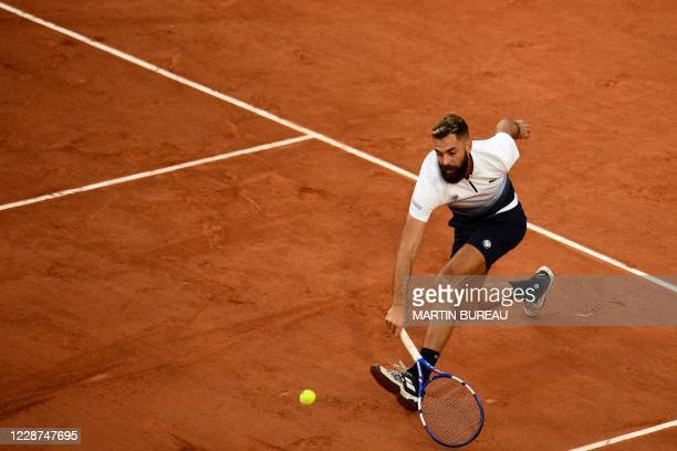 France's Benoit Paire plays a backhand return to South Korea's Kwon Soon-woo during their men's singles first round tennis match on Day 1 of The...