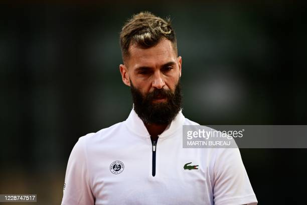 France's Benoit Paire reacts as he plays against South Korea's Kwon Soon-woo during their men's singles first round tennis match on Day 1 of The...