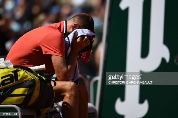 France's Benoit Paire reacts at the end of his men's singles first round tennis match against Norway's Casper Ruud on Day 2 of The Roland Garros 2021...
