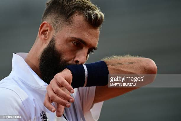 France's Benoit Paire reacts during the men's singles second round tennis match against Argentina's Federico Coria on Day 4 of The Roland Garros 2020...
