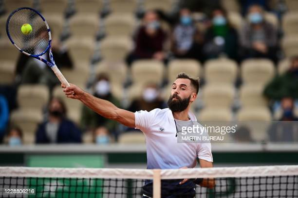 France's Benoit Paire returns the ball to Argentina's Federico Coria during their men's singles second round tennis match on Day 4 of The Roland...