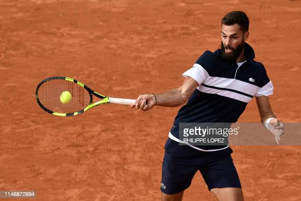 France's Benoit Paire returns the ball to France's PierreHugues Herbertduring their men's singles second round match on day four of The Roland Garros...