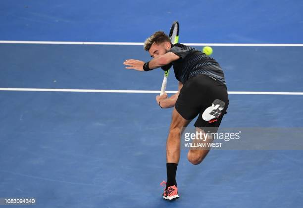 France's Benoît Paire avoids being hit by the ball from a shot by Austria's Dominic Thiem during their first round men's singles match on day two of...