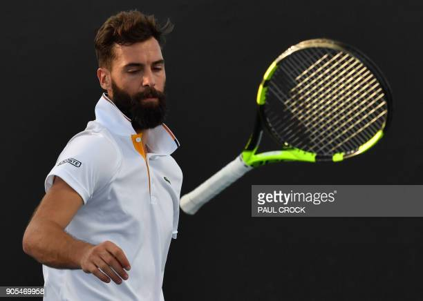 France's Benoît Paire looks at his racquet in the air after he threw it to the court during his men's singles first round match against Spain's...