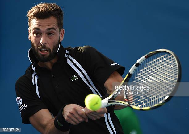 France's Benoît Paire plays a backhand return during his men's singles match against Noah Rubin of the US on day one of the 2016 Australian Open...