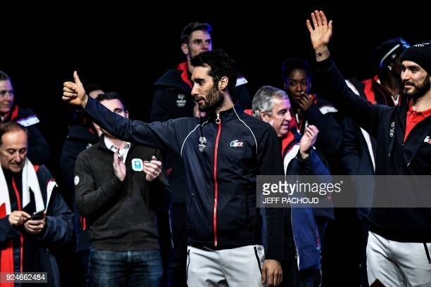 France's biathlon champion Martin Fourcade gestures on stage during an event at Alpexpo in Grenoble on February 26 2018 for the French Olympic...