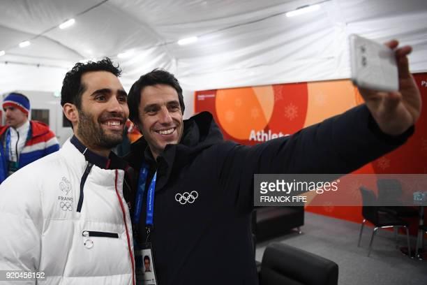 TOPSHOT France's biathlon double gold medallist Martin Fourcade poses for a selfie with Paris 2024 president Tony Estanguet backstage at the...