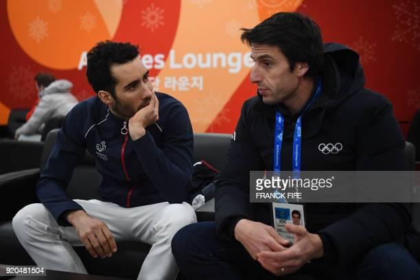 France's biathlon double gold medallist Martin Fourcade speaks with Paris 2024 president Tony Estanguet backstage at the Athletes' Lounge ahead of...