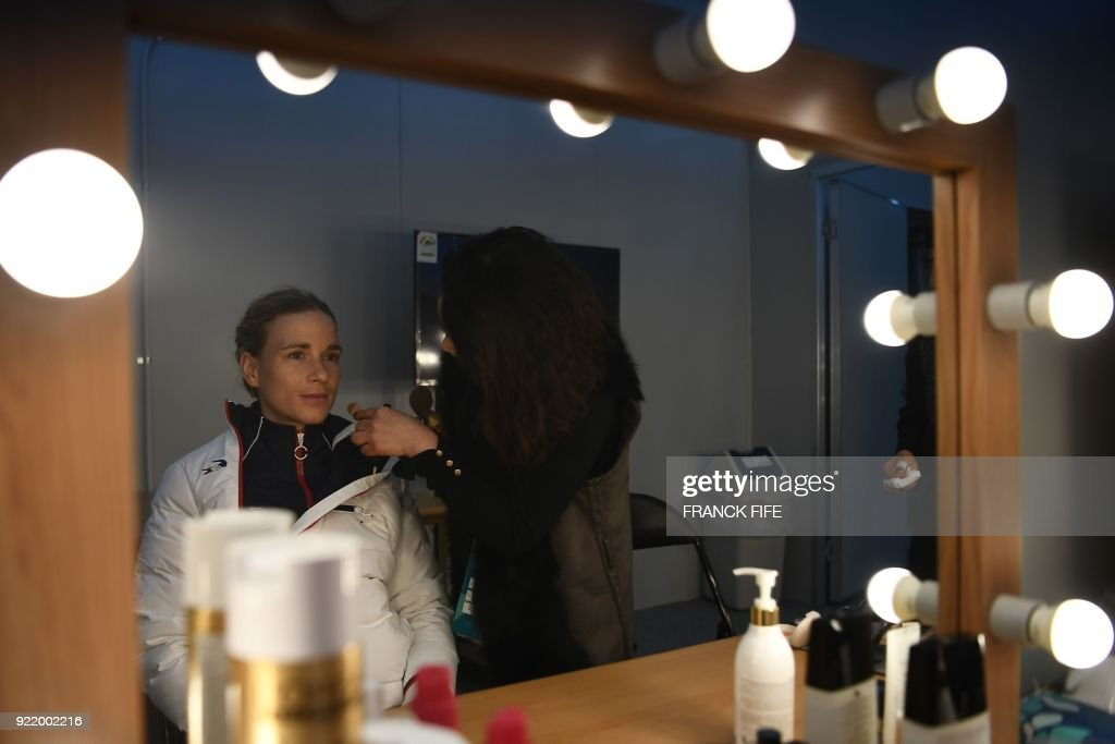 France's biathlon gold medallist Anais Bescond gets ready backstage at the Athletes' Lounge during the medal ceremonies at the Pyeongchang Medals Plaza during the Pyeongchang 2018 Winter Olympic Games in Pyeongchang on February 21, 2018. /