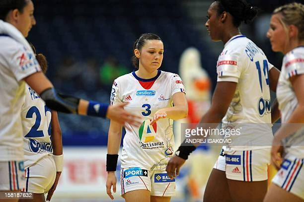 France's Blandine Dancette reacts with teammates after losing to Norway on December 10, 2012 during a women's EHF Euro 2012 Handball Championship...