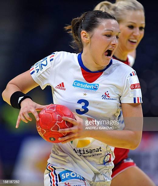 France's Blandine Dancette vies with Norway's Linn Jorum Sulland during their Women's EHF Euro 2012 Handball Championship match Norway vs France on...