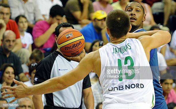 France's Boris Diaw is blcked by Lithuania's Paulius Jankunas during the preliminary round match of the Group D between Lithuania and France at the...