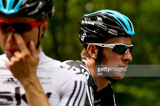 France's Bradley Wiggins flanked by teammate Norway's Edvald Boasson Hagen gets ready before participating in a training session for Great Britain's...